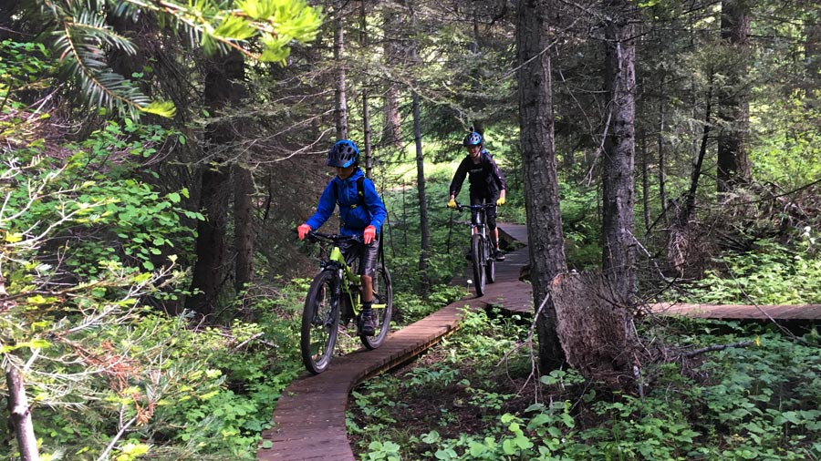 Cruising along on a wood feature in the Bear Basin trail system near McCall, Idaho