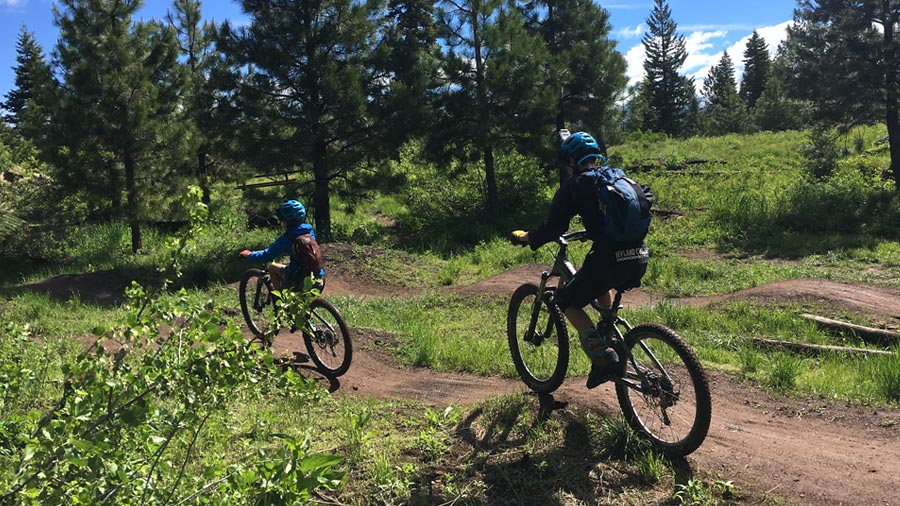 Riding the pump track at the Bear Basin skills park near McCall, Idaho