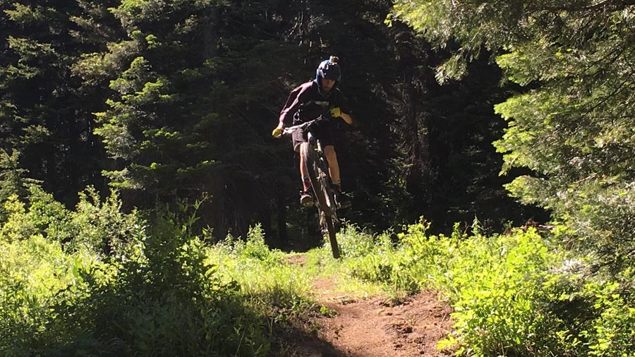 Doing a jump on the pedal trails near Tamarack Resort, Idaho