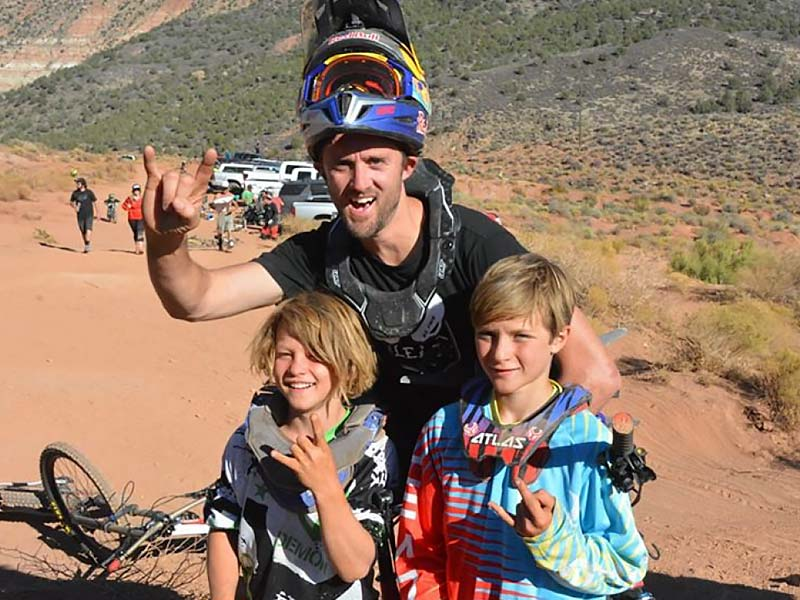 Pro mountain biker Aaron Chase with a couple of kids