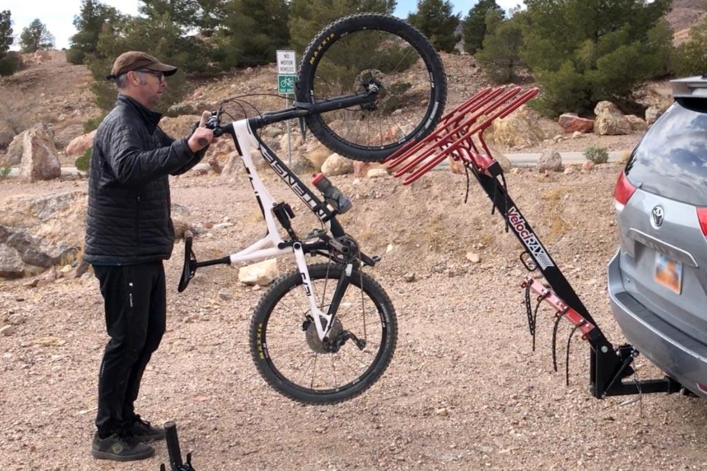 Loading a mountain bike into the Velocirax 4x vertical bike rack