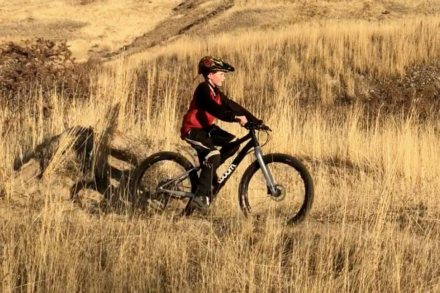 Woom Off 5 Review - youth mountain biker on 24 inch wheel bike