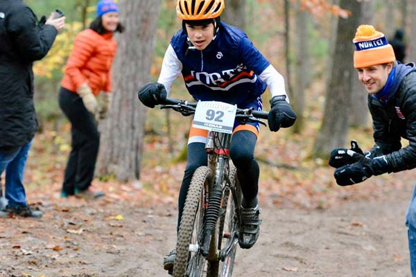 A young mountain biker races on the Norte club