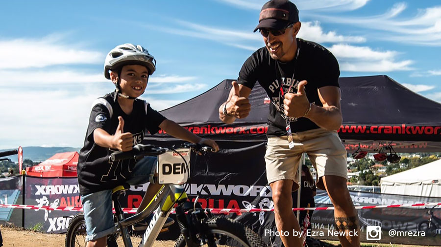 Marcello Ojerio assists a rider at the 2017 Kidsworx Rotorua pump track