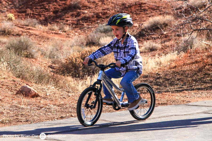 Riding a real bike for the first time only happens once. The look on this kid's face says it all.