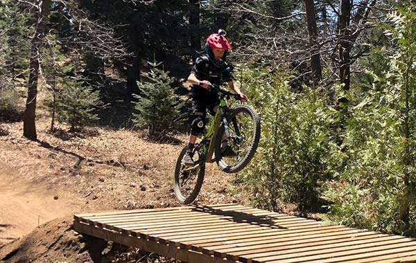 Our young gun starts to get some air on the Arrow trail.