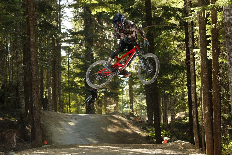 Dillon Flinders hucks a double on A Line in the Whistler Bike Park
