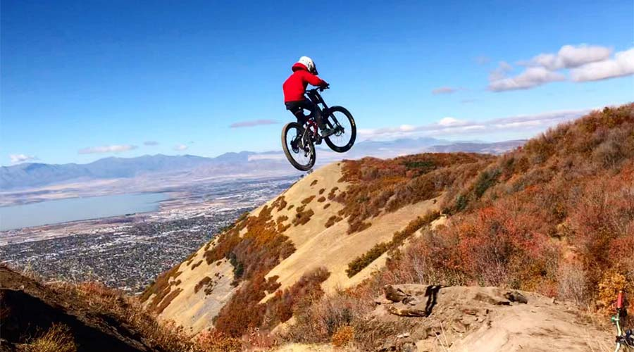 Mountain biker Finley Kirchenmann takes flight above the Wasatch Front