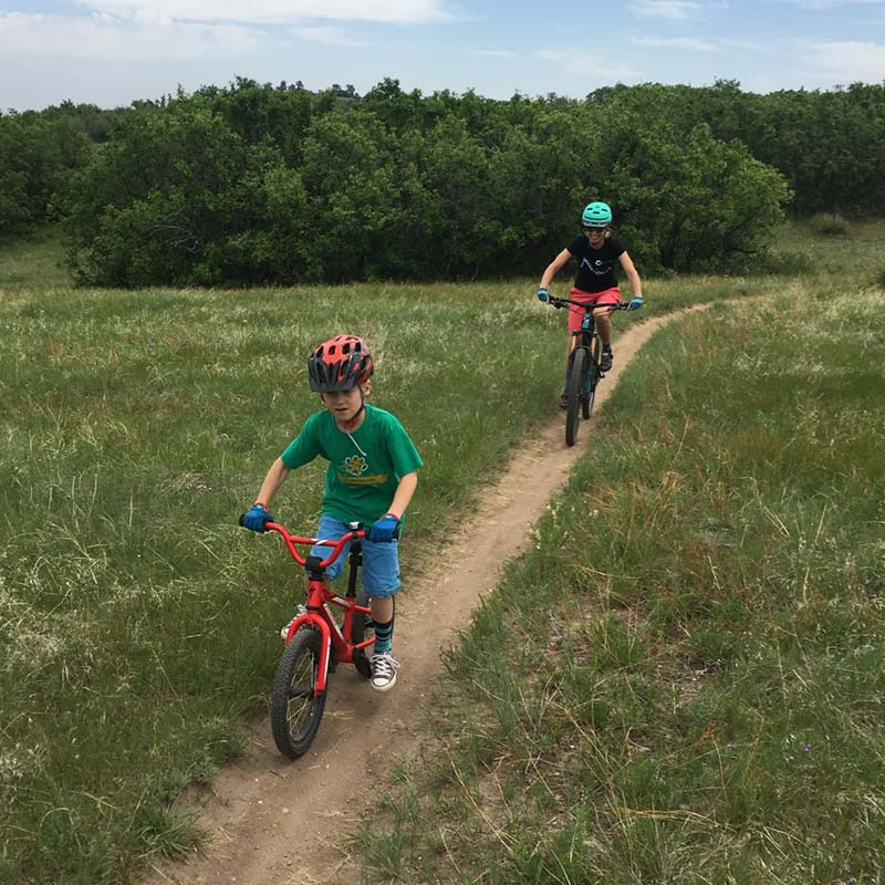 Julie's son leads the way on a mountain bike ride