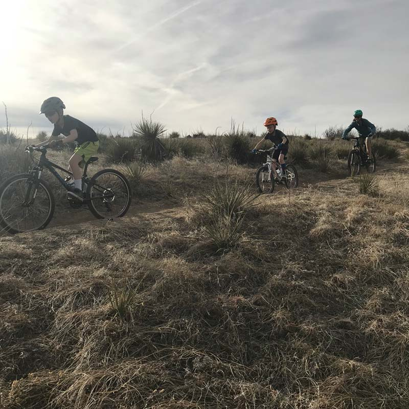A mom and her kids out for a mtb ride