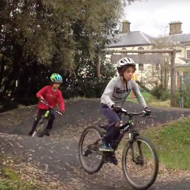 Brothers riding the pump track