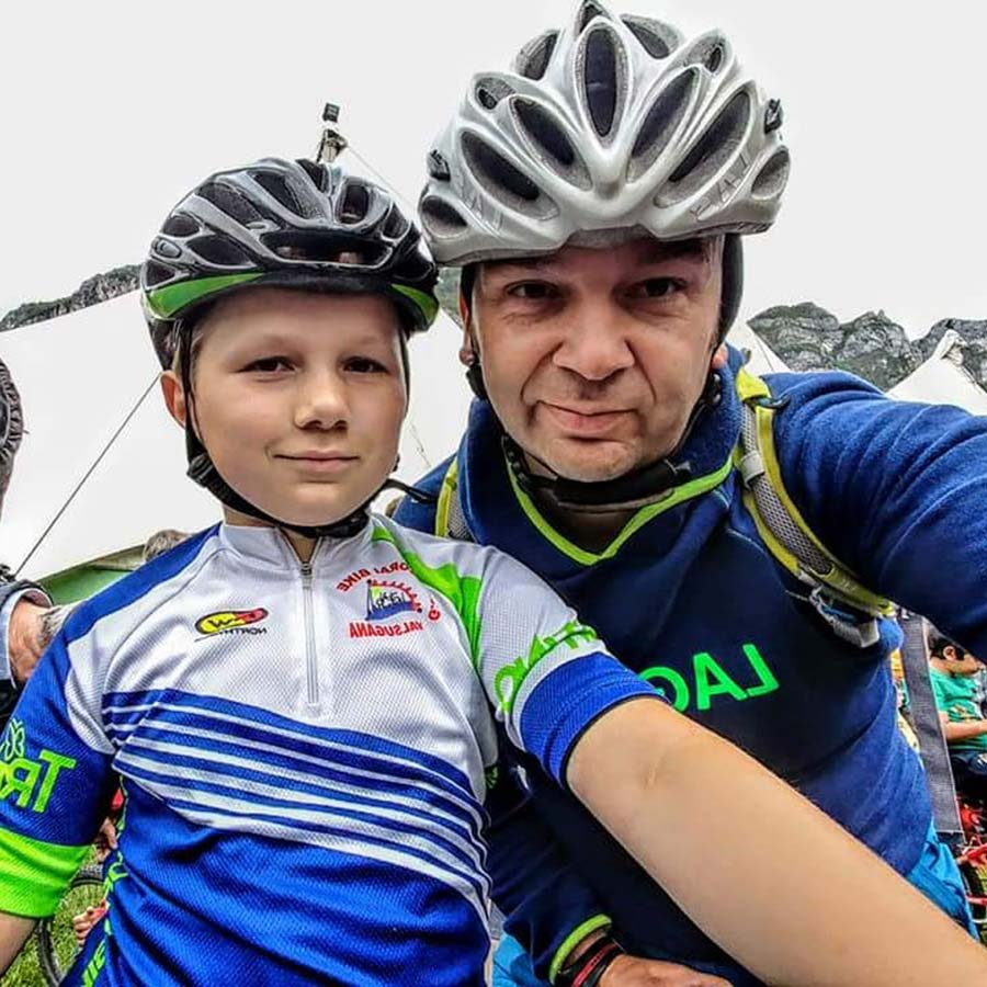 Mountain biking father and son