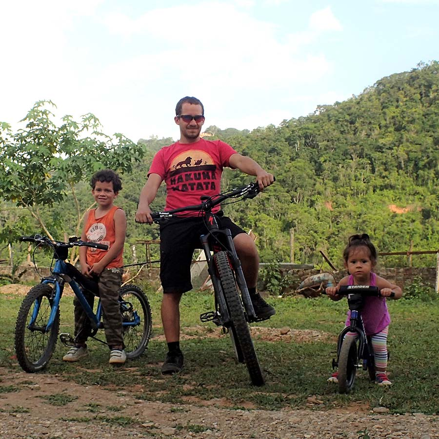 Mountain biking dad with his kids