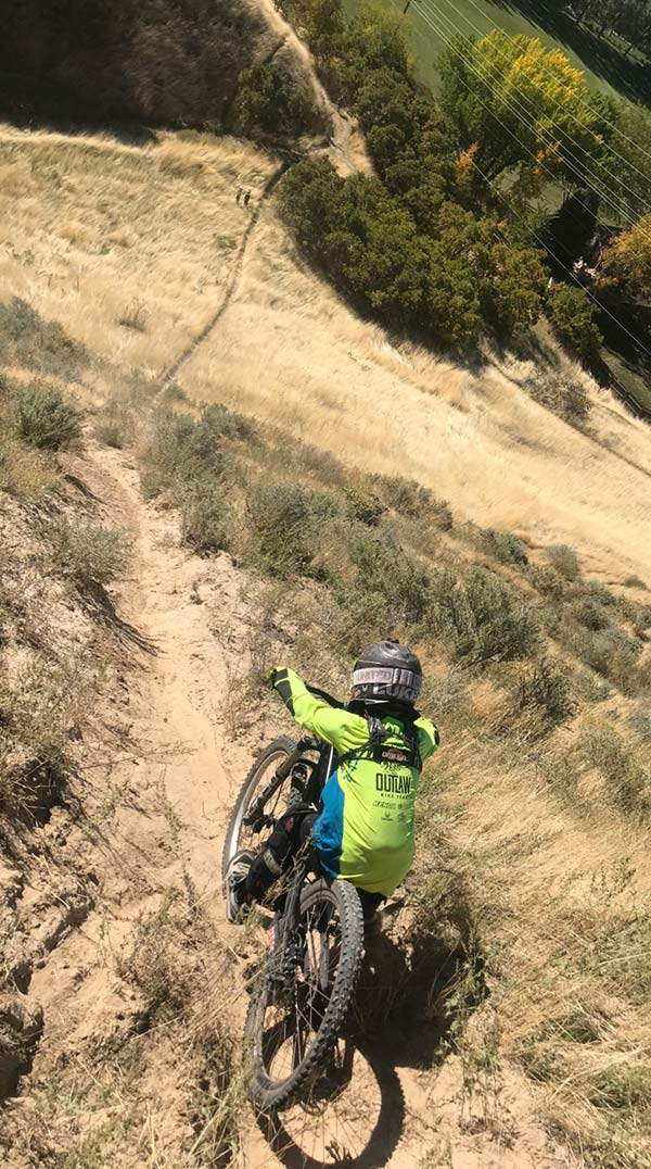 A mountain biker irons out something sketchy in the Provo foothills