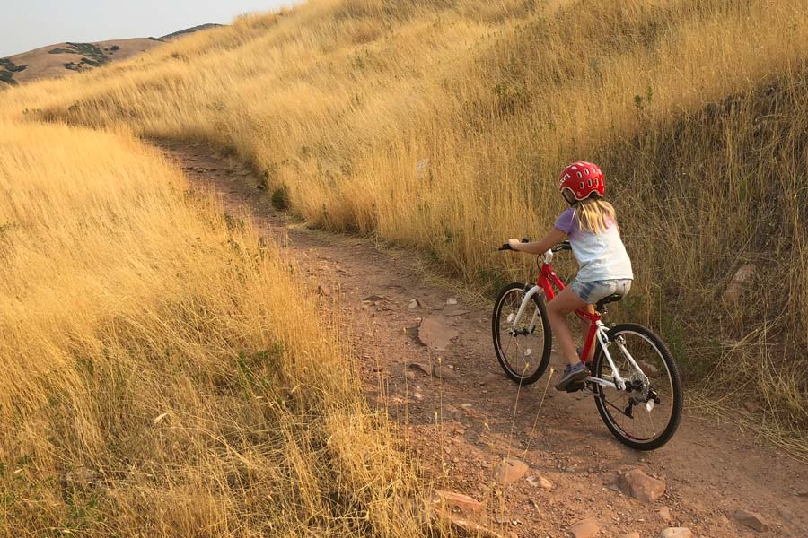 Climbing a dirt bike path on the Woom 5 kids' bike