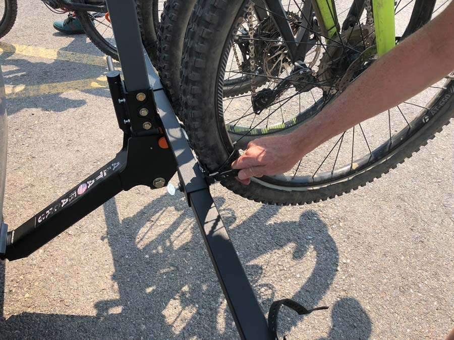Fastening the bottom wheel of a bike on the Alta Racks, Alta Six GPR bike rack