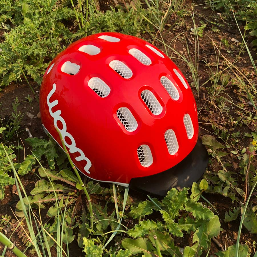 You can see the fly netting in the vents of the Woom kid-sized bike helmet
