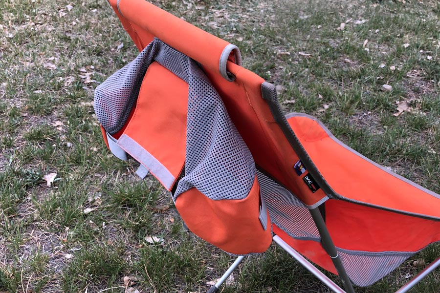 Storage bag attached to back of Helinox camping chair