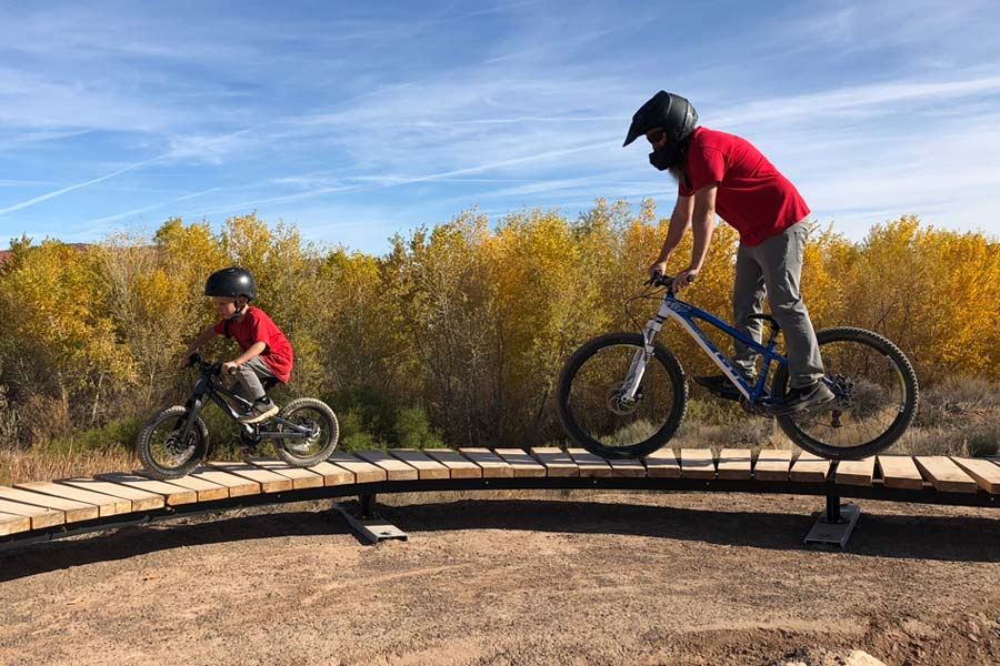 Son and dad riding together