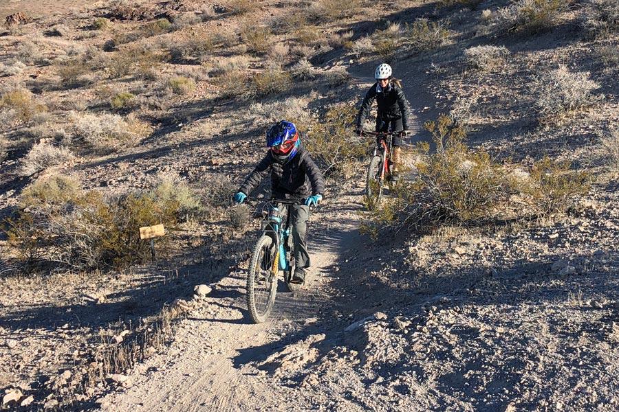 Mother and son riding Inner Caldera trail at Bootleg Canyon MTB park