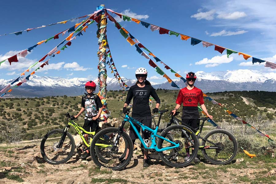 MTB mom and kids model the Yeti SB100