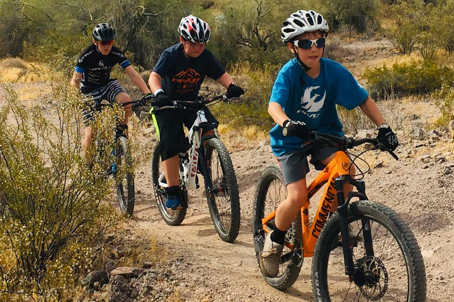 Webster boys mountain biking in the desert
