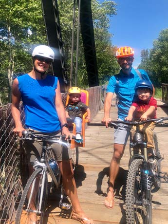 Young family mountain biking with kids