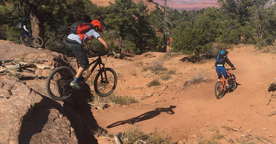 Sending a drop on The Whole Enchilada mtb trail - Moab, UT