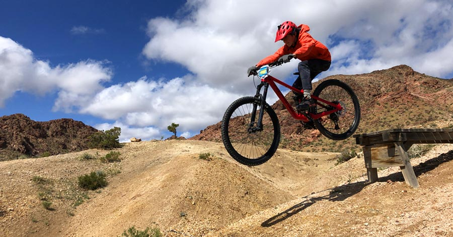 Our rider gets the Norco Sight 27.5 off a drop and in the air