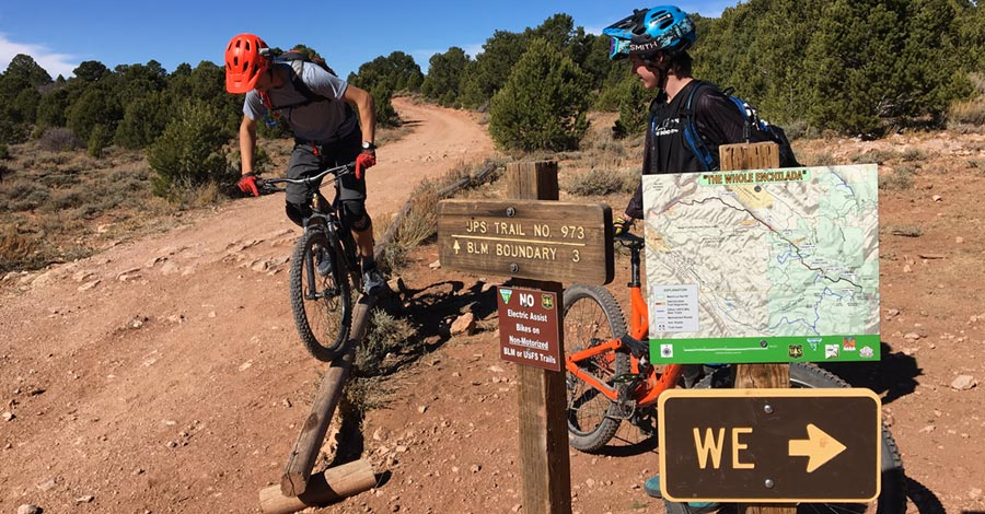 Horsing around at a trail junction on the Whole Enchilada mtb trail - Moab