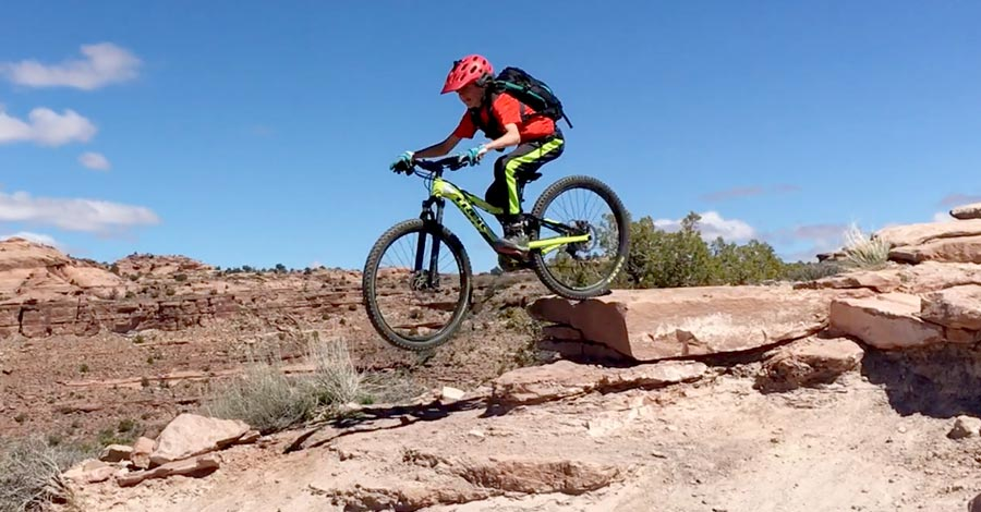 Tyge sends a drop while riding The Whole Enchilada in Moab