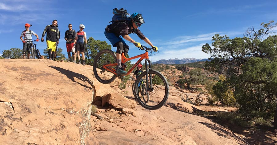 Wyatt sends a drop while riding The Whole Enchilada near Moab, Utah