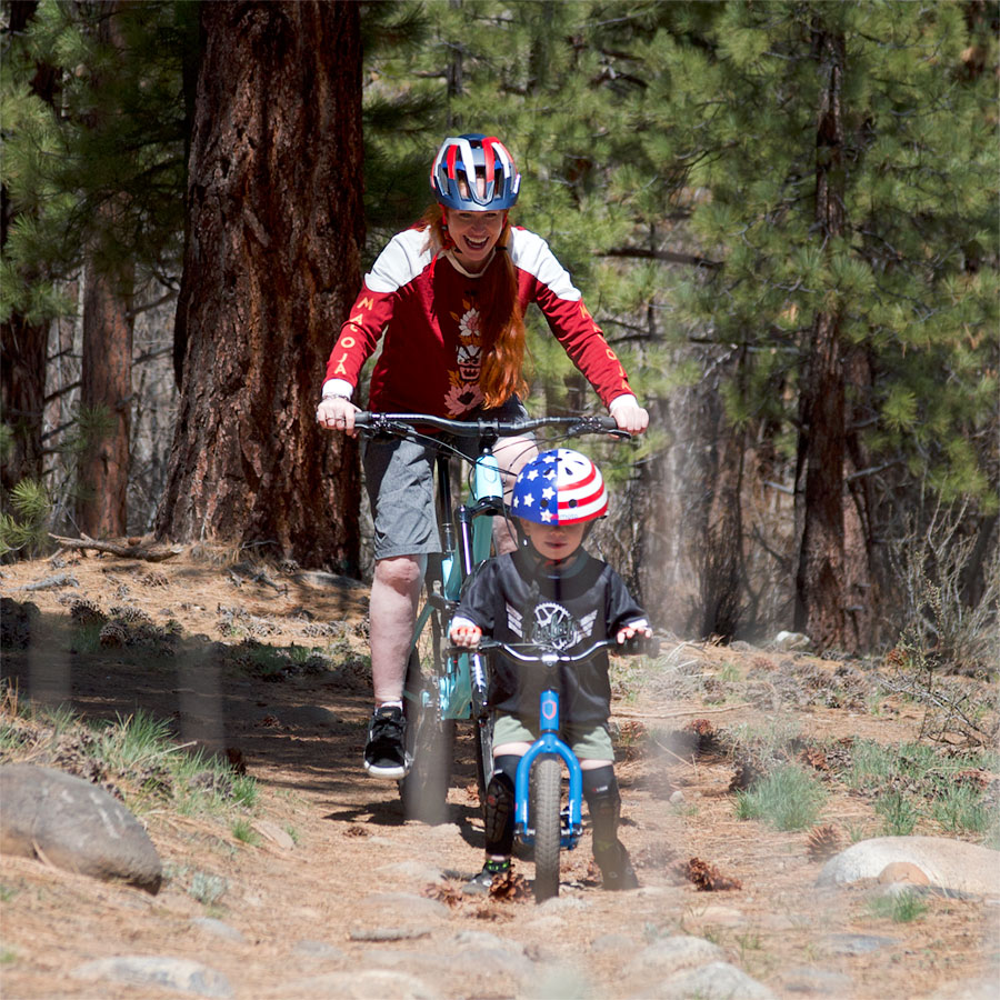 Adrienne and son mountain biking