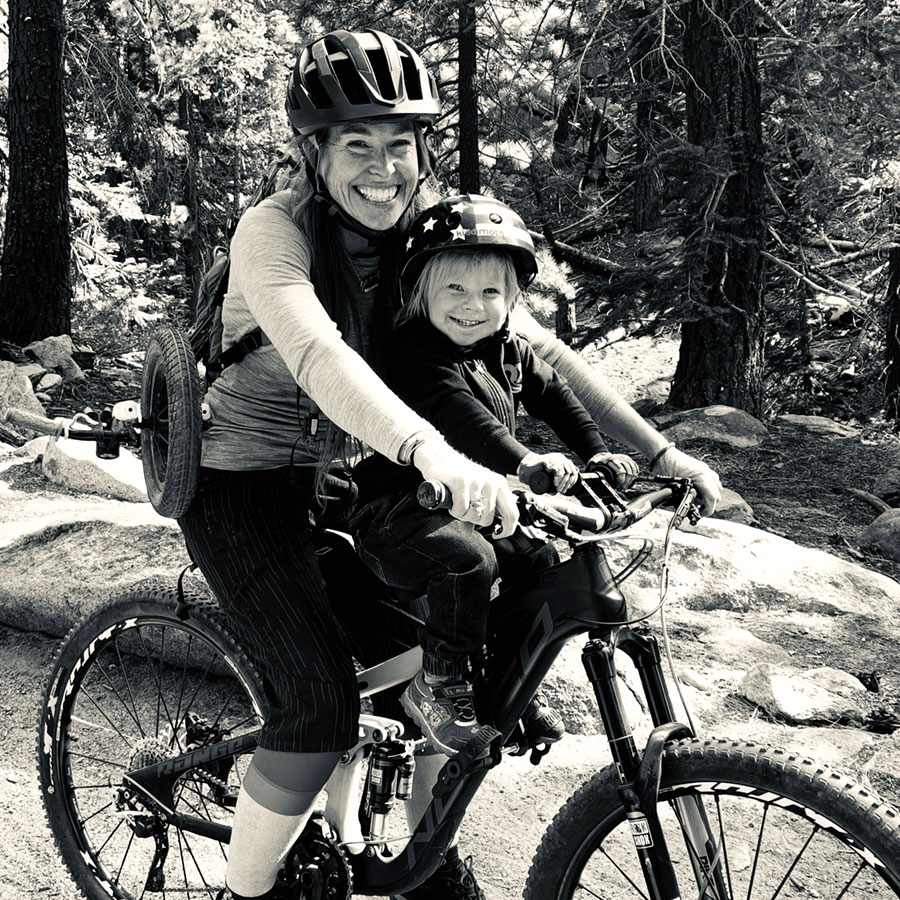 Adrienne and son are all smiles when mountain biking together