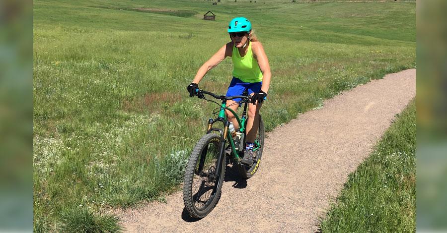 Lisa Sklar riding her custom built Sklar mountain bike