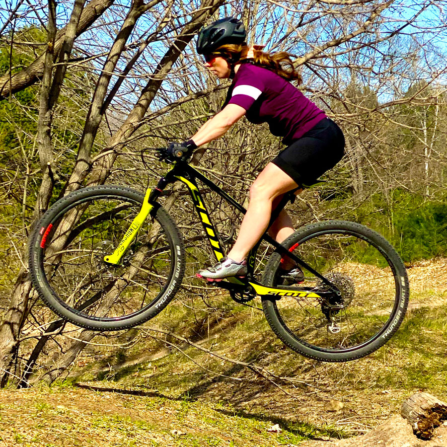 Shannon Kochis jumps on her Scott mountain bike