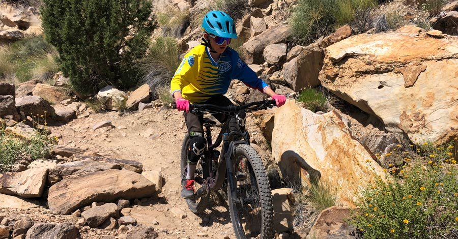 Kid riding mountain bike with the Bontrager Quantum helmet