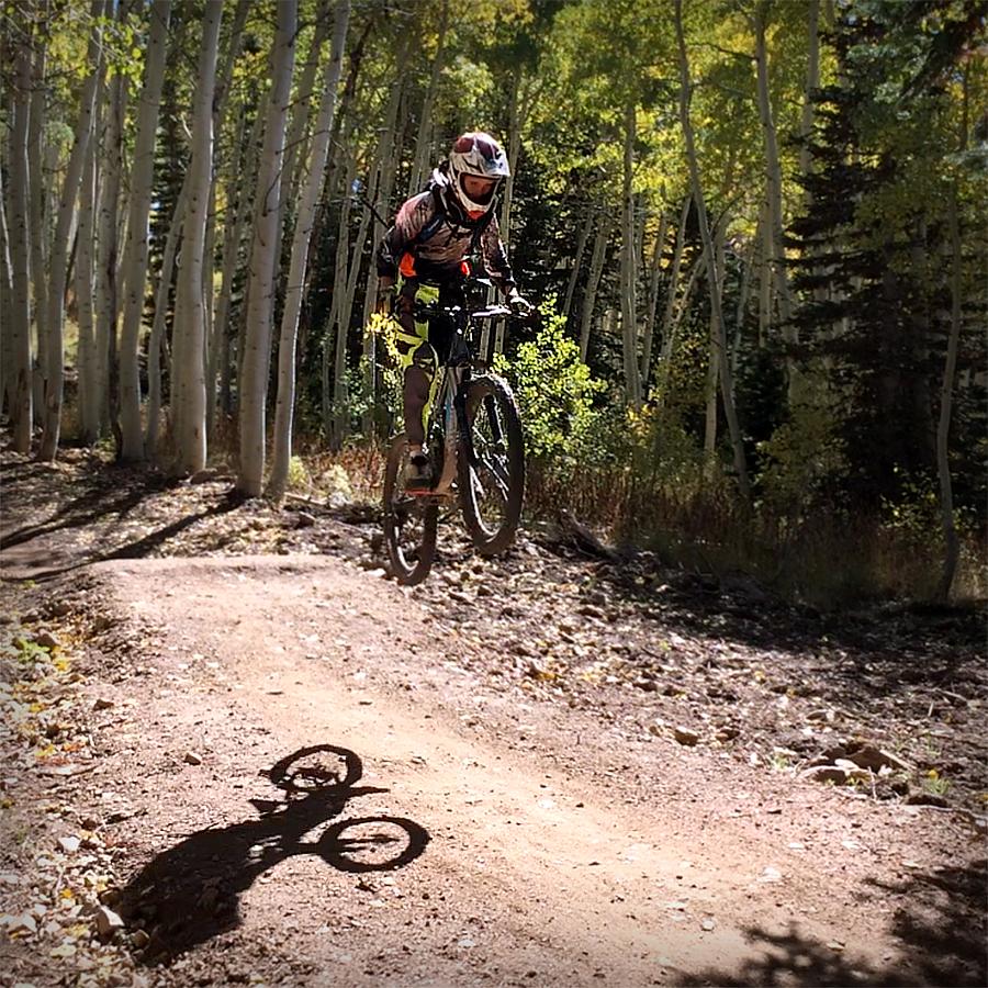 Grom sending a jump at Deer Valley Resort - Park City Mountain biking for families