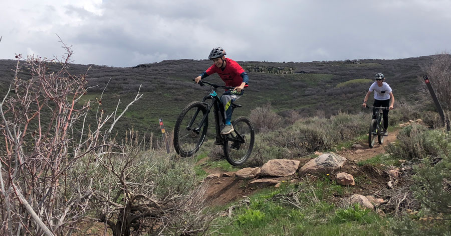 Kid riding the The Drop Our - Park City mtb trails for families and beginners