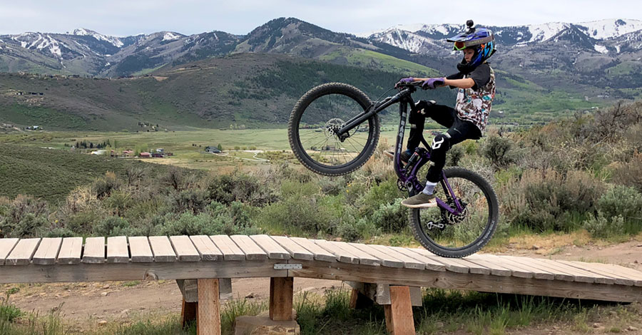 Pulling a wheelie at Park City's Trailside Mountain Bike Park