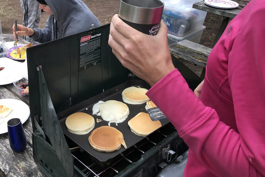 Making pancakes on our Coleman stove with griddle