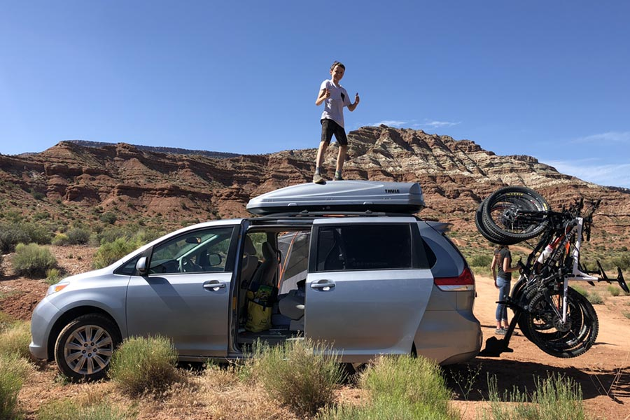 We use a Thule roof box for our mtb road trips