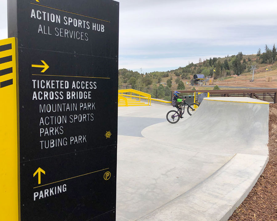 Outdoor plaza signage at Woodward Park City