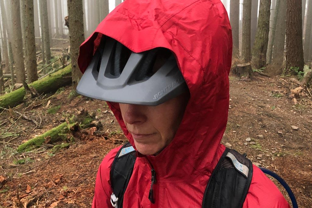 Hood over mtb helmet on the Bontrager Avert Women's Rain Jacket