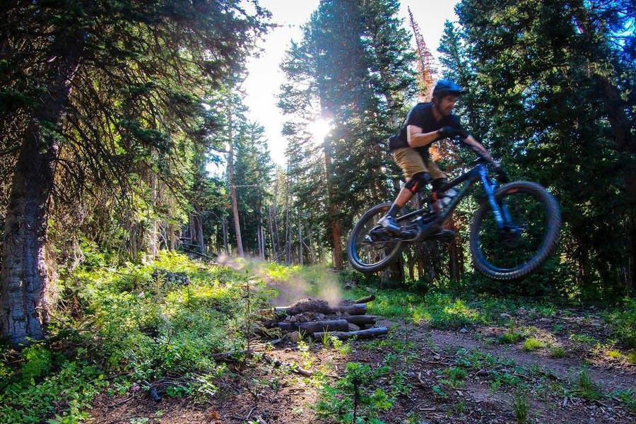 Tim McChesney trades in the skis for mountain biking during the summer in Park City, UT